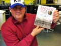 Former England fast-bowlerDarren Gough with a copy of Empire, War and Cricket